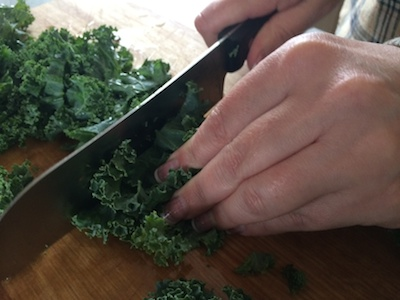 Chopping kale to bite sized pieces